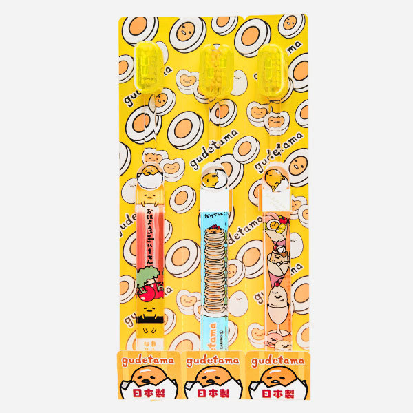 15674  sanrio gudetama children's toothbrush set   packaged
